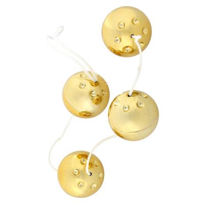 Четыре золотистых вагинальных шарика